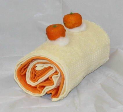 Handtuchrolle / Handtuchtorte, bestehend aus 2 Gästetüchern, Farbe je Natur und Mandarine